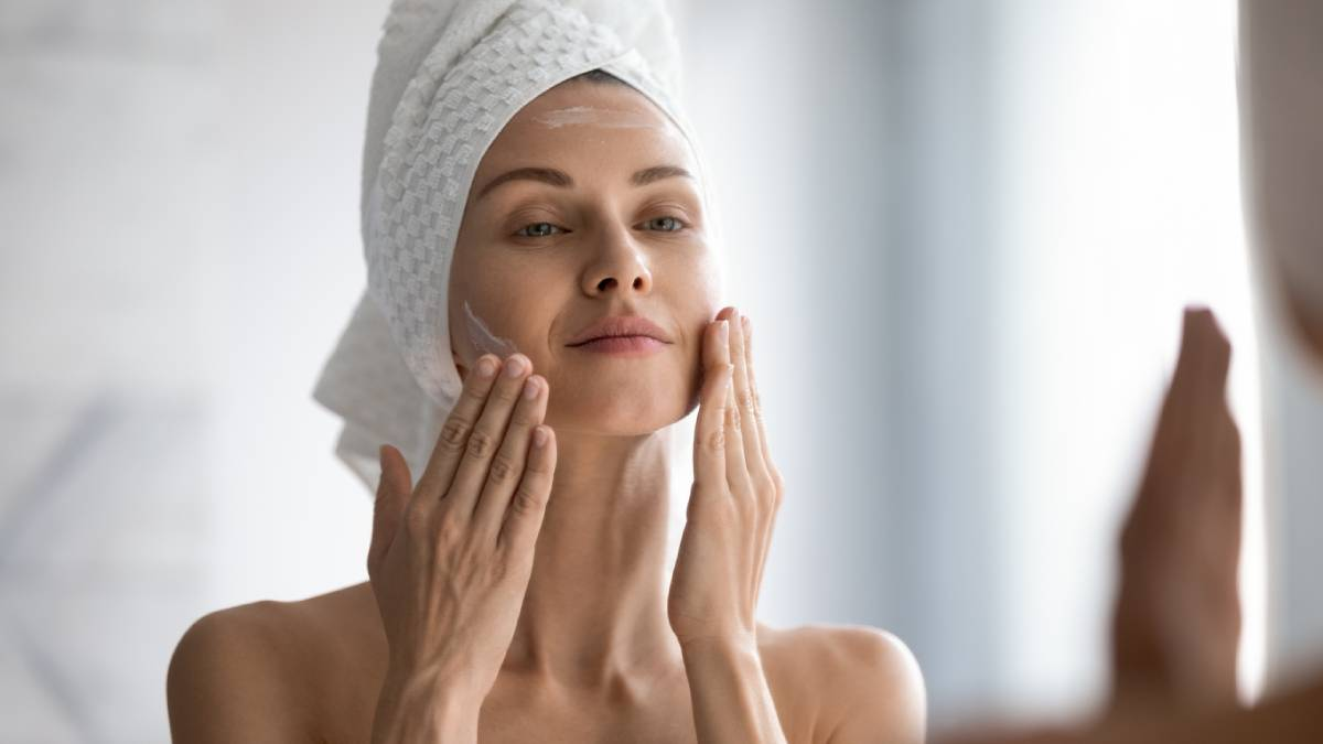 Woman caring for her skin after a facelift.
